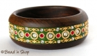 Green Bangle Studded with Metal Accessories & Rhinestones