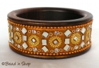 Golden Colored Bangle Studded with Mirrors & Accessories